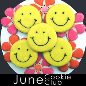 June Cookie Club - Yellow smiley face cookies and pink and orange flower cookies